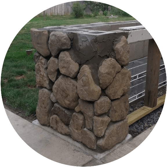Placing fieldstone on a grill island
