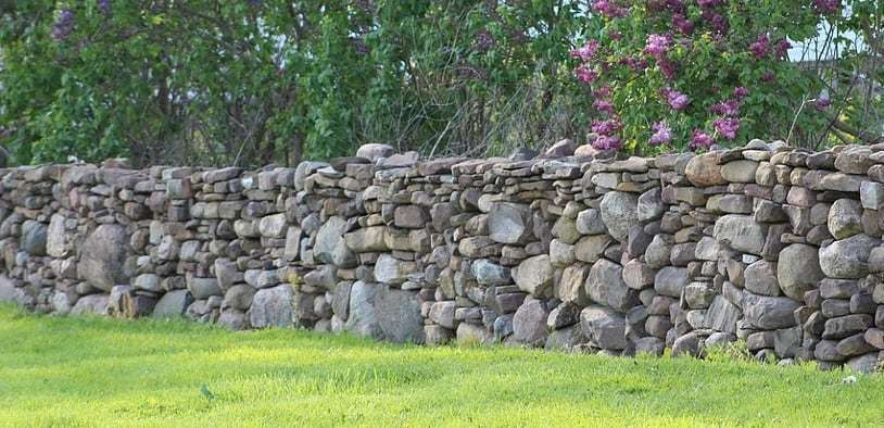 well made dry stacked stone wall