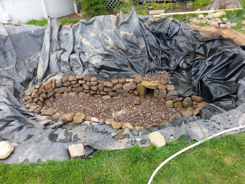 building a pond with a fish cave using natural stone