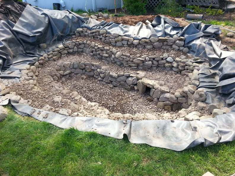 build a pond with natural stone and layers