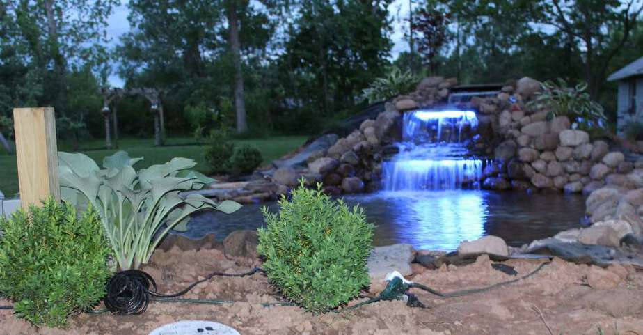 backyard waterfall pond with color changing LED lighting