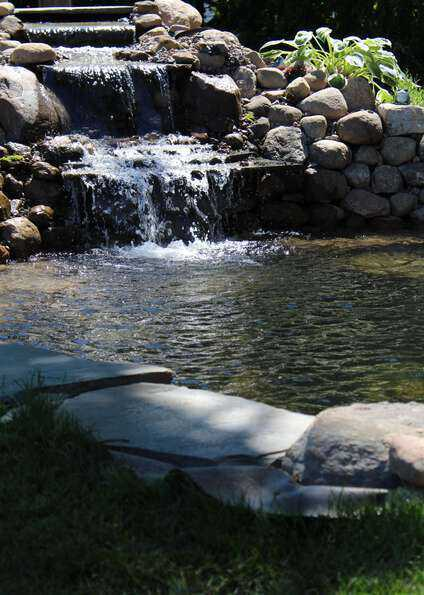 relaxing backyard waterfall koi pond