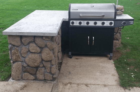 cinder block grill island with concrete countertop