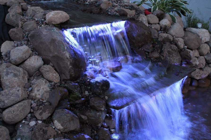 color changing backyard waterfall pond