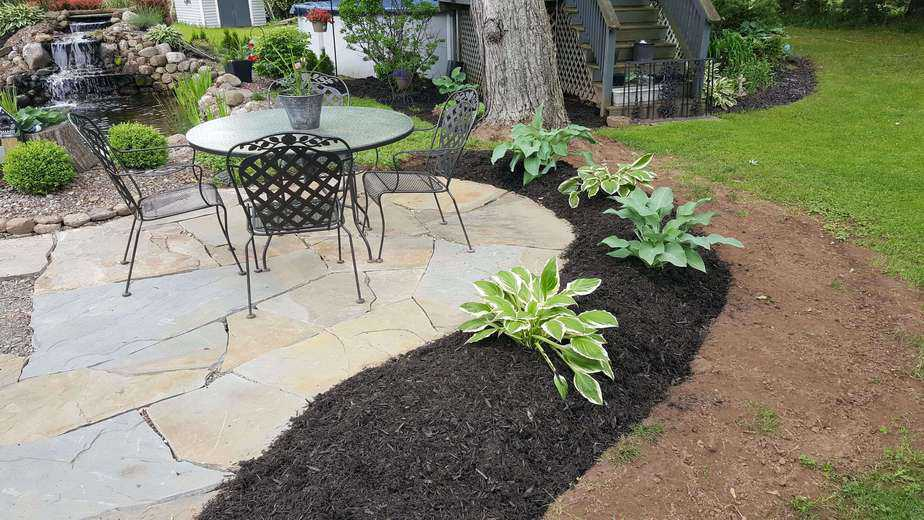 planting and mulch around a flagstone patio