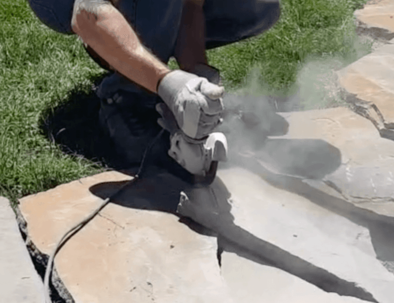 cutting flagstone with 4 and a half inch grinding wheels and an angle grinder