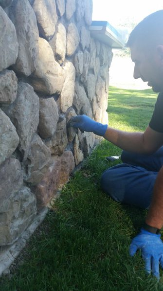 Grouting field stone in grill island