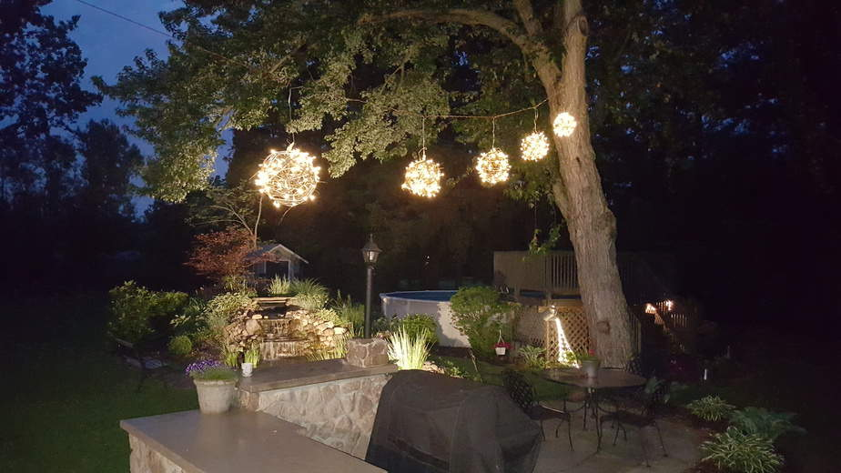 grapevine ball lights hanging above bar